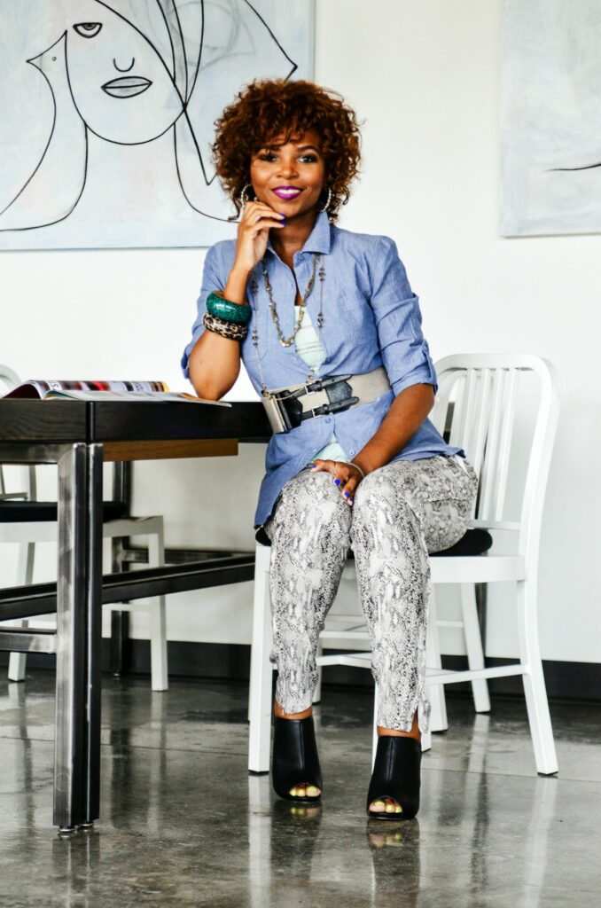 When you own your own business you can set the tone of the work style. On more casual days add standard items to a daring pair of pants and a sexy bootie. (Shirt, tank, and pants, Profyle Boutique; shoes, belt and accessories by way of Styles By M.E. LLC personal collection)